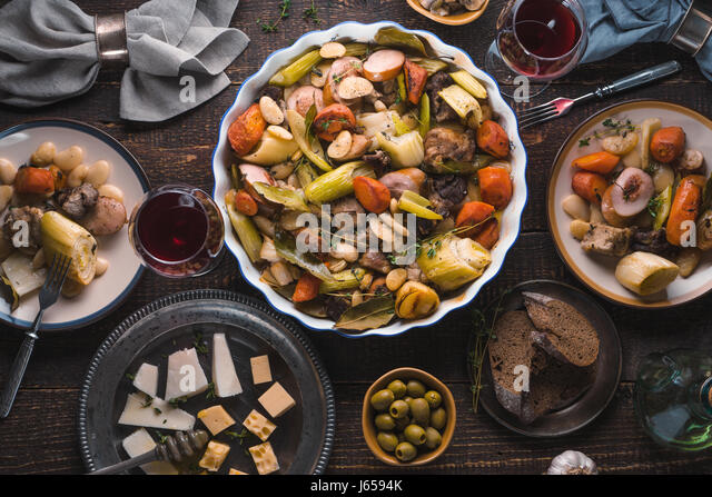 Kasul, cheese, wine, vegetables on the table closeup - Stock Image