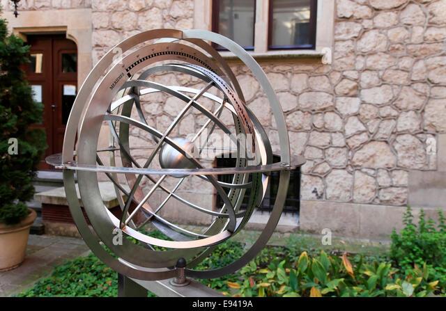 Armillary Sphere In The Professors Garden At The Jagiellonian University Of  Krakow, Poland.