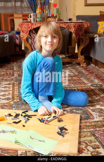 Put Together Toys For Boys : Little boy putting on stock photos