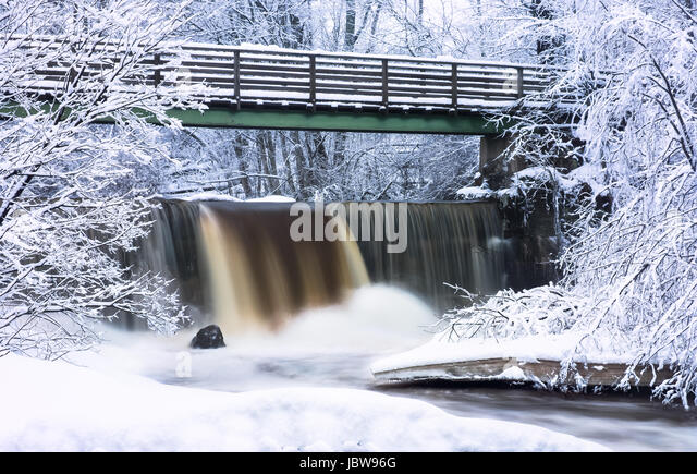 enic landscape with flowing river at winter morning - Stock Image