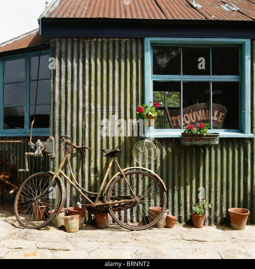 Corrugated metal shed stock photos corrugated metal shed stock old bicycle leaning against corrugated metal shed with pale blue window stock image sciox Images