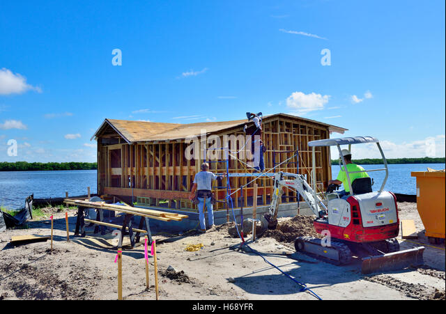 Timber frame house stock photos timber frame house stock for Wood frame house in florida