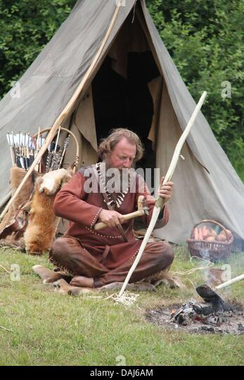 Experimental archeologist Werner Pfeifer sits in front of a c&fire crafting self-made stone- & Albersdorf Stock Photos u0026 Albersdorf Stock Images - Alamy