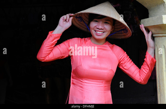 Female tourist guide posing wearing traditional vietnamese dress and