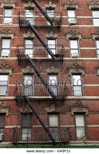 Old Tenement Apartments With Fire Escapes In New York City, NY, USA.