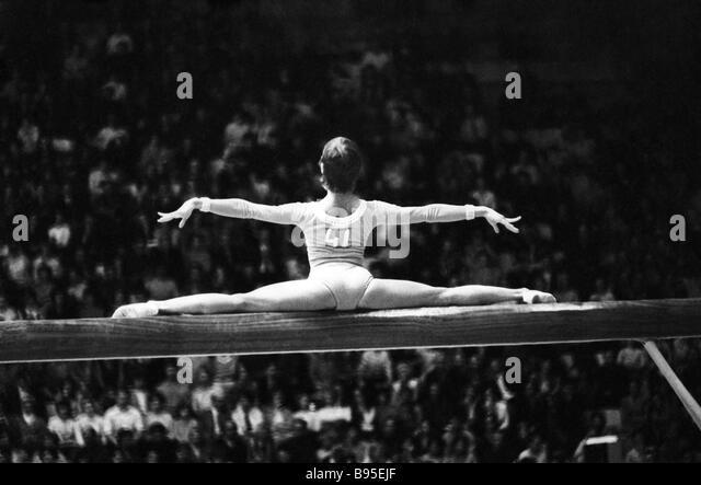 soviet gymnast olga korbut on the balance beam stock image
