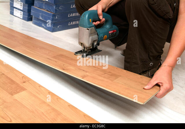 Woman sawing wood stock photos