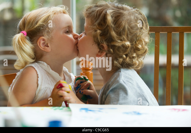 Little boy and girl kissing stock photos little boy and girl little boy and girl kissing stock image altavistaventures Images