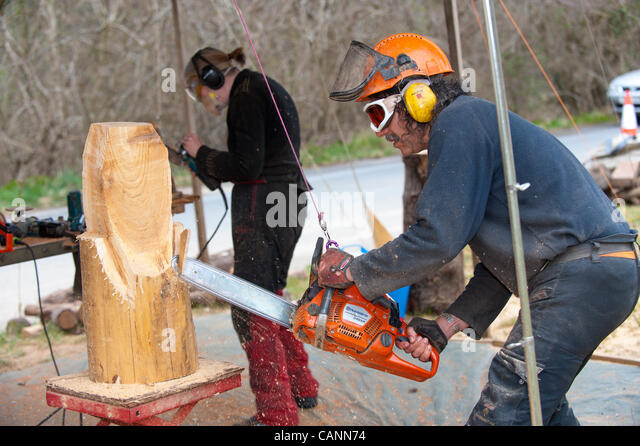 Wood carver carving owl stock photos