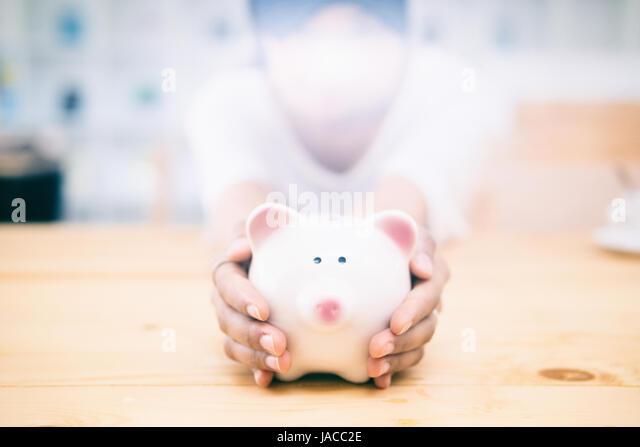 saving money,piggy bank saving,business saving money concept,business economy idea,selective focus and vintage color - Stock Image