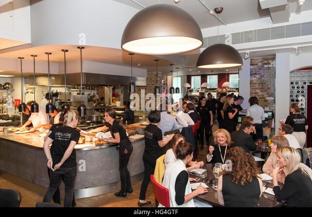 Restaurant Kitchen Brigade kitchen brigade stock photos & kitchen brigade stock images - alamy