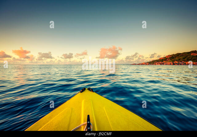 Sailing on yellow boat near Seychelles, La Digue island - Stock Image
