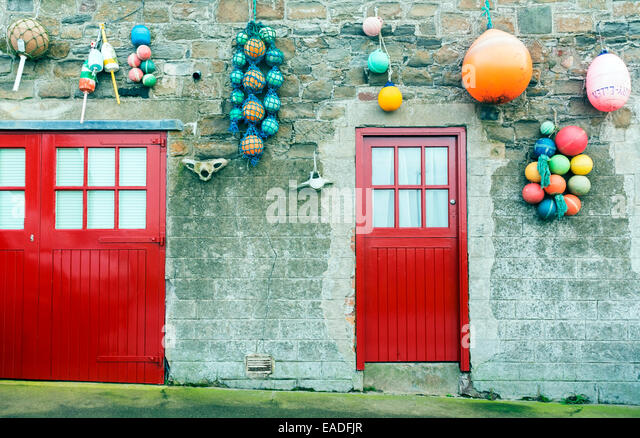 Collage of 36 colourful front doors to houses from karpathos greece