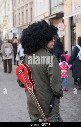 Musician With A Guitar On His Back