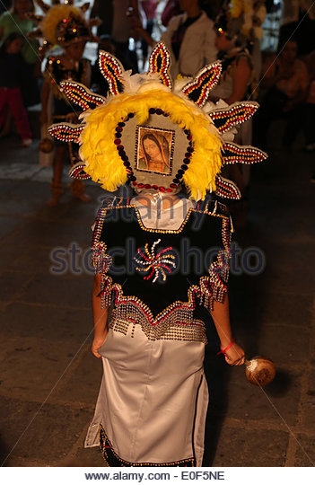 a dancer in a parade at the festival of our lady of guadalupe in puerto vallarta