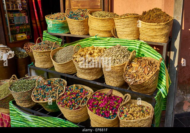 Baskets of dried flowers, rose petals, buds and herbs in the souk ...