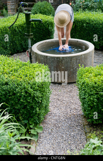 Lady water can stock photos lady water can stock images for Filling in a pond
