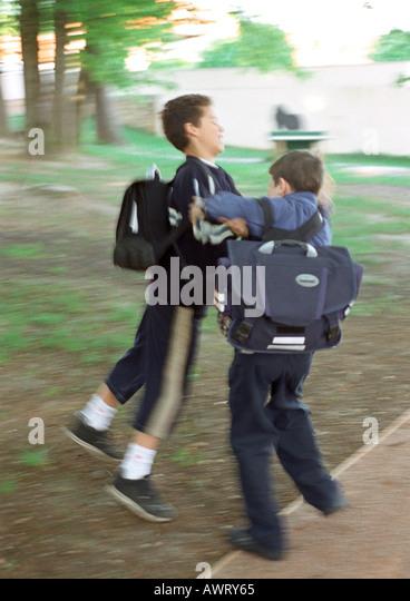Boys Fighting Playground Stock Photos & Boys Fighting ...