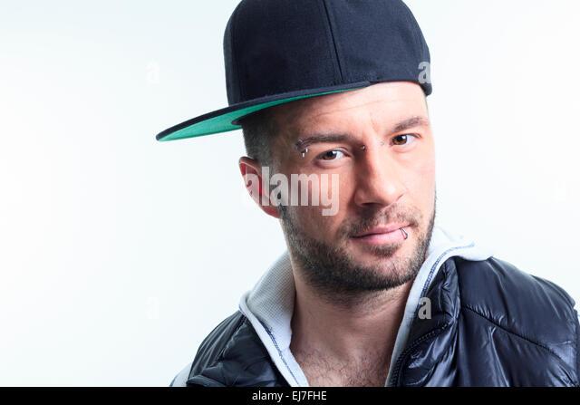 urban man wearing baseball cap caps in europe hair loss winter