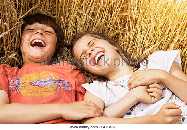 Brother Sister Lying In Field Stock Photos & Brother ...
