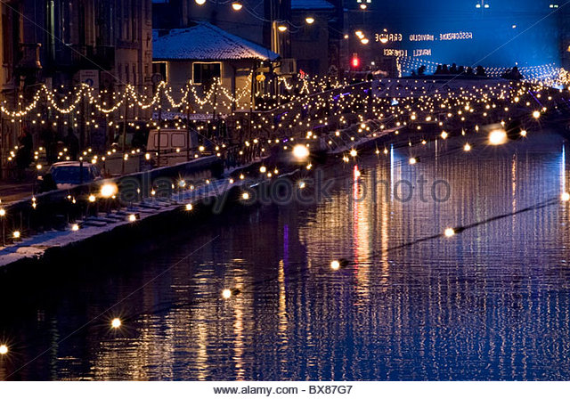 milan christmas lights on naviglio grande canal after a snowfall stock image - Snowfall Christmas Lights