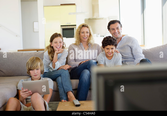 family watching tv together stock photos amp family watching