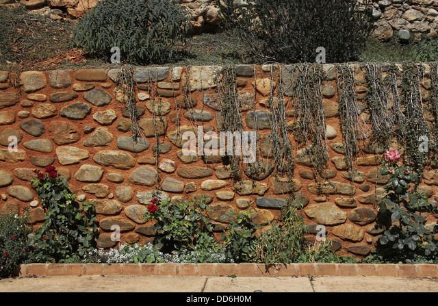 A Burnt Orange Cobblestone Wall Found In The Alhambra, Spain.   Stock Image