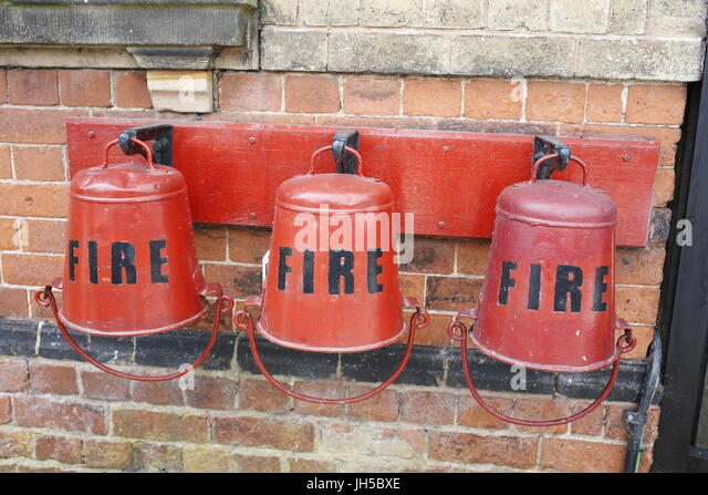 Red fire buckets - Stock Image