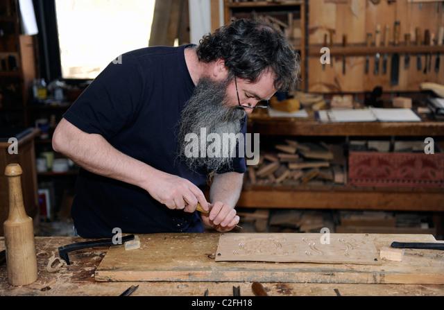 Wood carving english stock photos