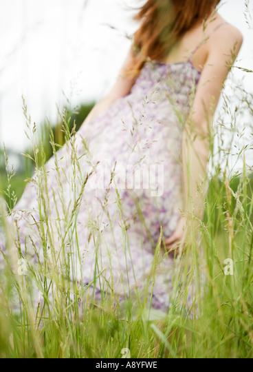 woman walking in grass - photo #5