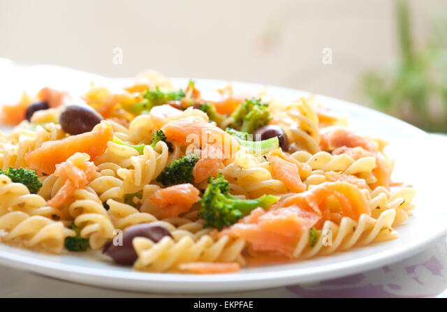 Delicious Plate Of Pasta For Lunch Consisting Of Spiral Pasta Broccoli Olive Smoke
