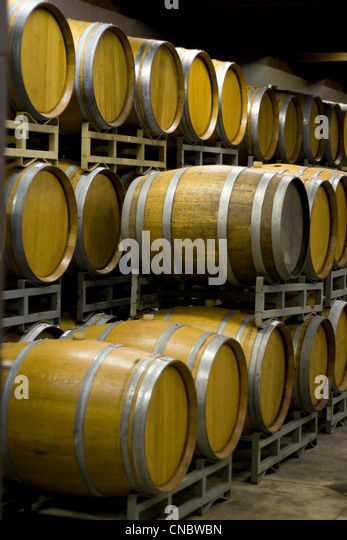 Stacked Oak Wine Barrels In Winery Cellar Stock Photo, Picture And ...