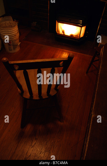 Superior Wooden Chair In Front Of Fire.   Stock Image