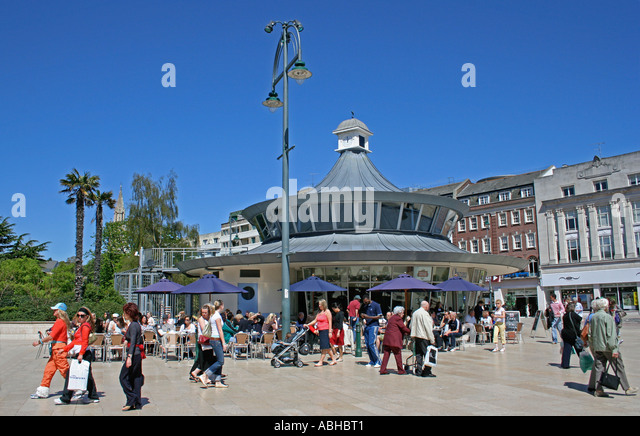 Entrance to shopping arcade with clock on a pedestrianised street off ...