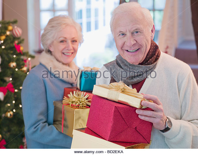 couple holding christmas gifts stock image
