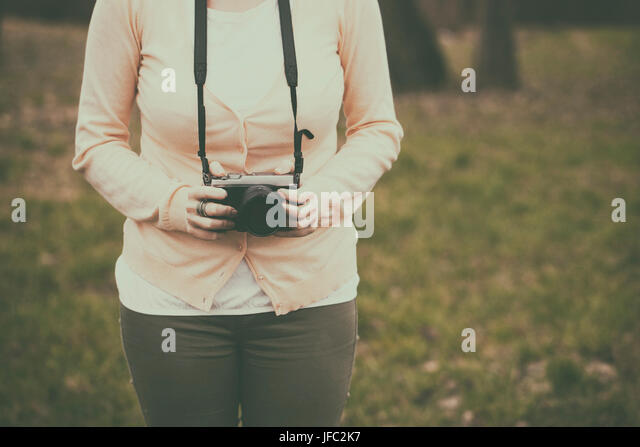 Woman with a retro camera - Stock Image
