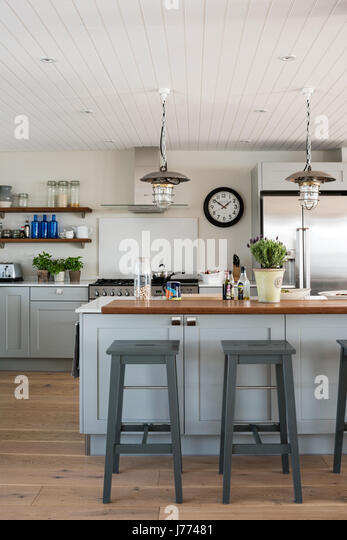 Reconditioned pendant lamps in bespoke Sylvarna kitchen - Stock Image