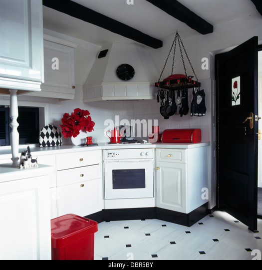 red accessories in black and white kitchen with blackwhite vinyl