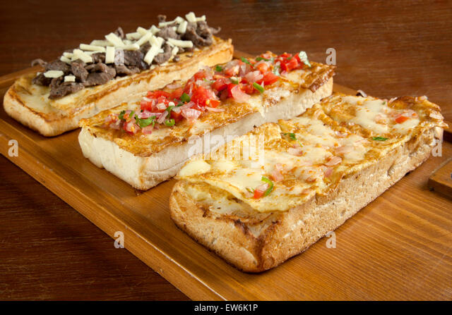 Tomato And Melted Cheese Open Faced Sandwich Recipe — Dishmaps