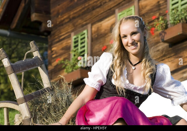 woman in dirndl on farm stock photos woman in dirndl on. Black Bedroom Furniture Sets. Home Design Ideas