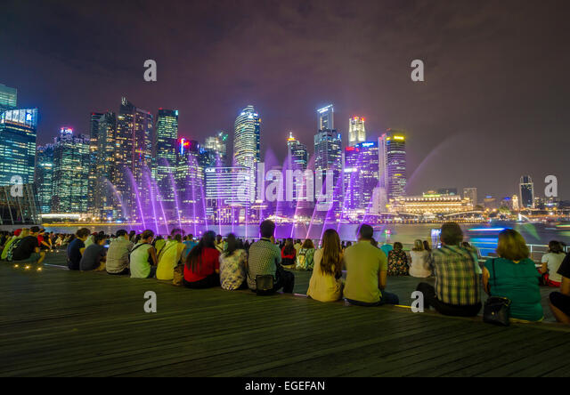 People Sitting And Watching The Wonder Full Light And Water Show At Marina Bay