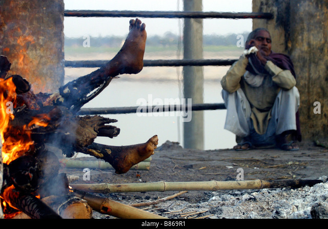 Indian's Burning The Funeral Pyre On The River Ganges