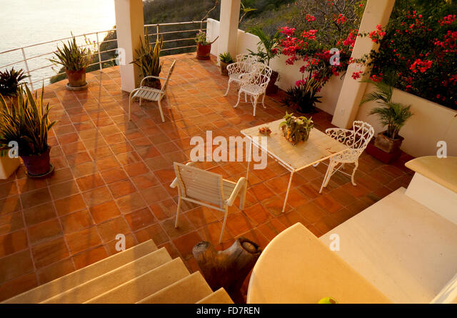 Red Clay Tiled Patio Terrace In Mexican Home Overlooking The Pacific Ocean.  Metal And Iron
