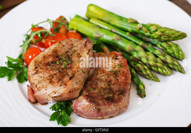 Barbecue Grilled Beef Steak Meat With Asparagus And Tomatoes Stock Image