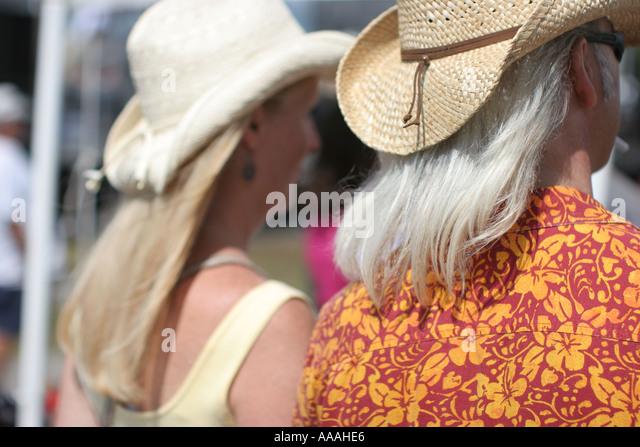 florida zydeco festival cajun couple long hair straw hats