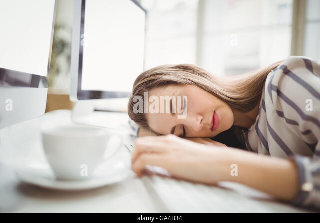 tired businesswoman taking nap in creative office stock image business nap office relieve