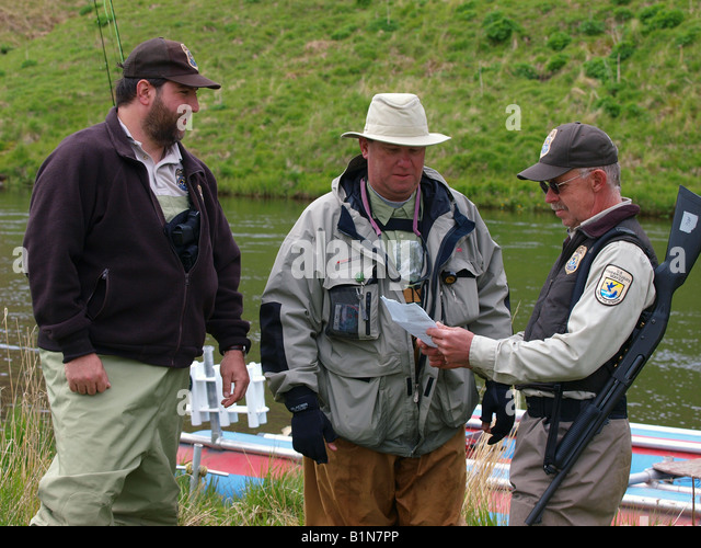 Fish and game officers stock photos fish and game for Fish and wildlife permit