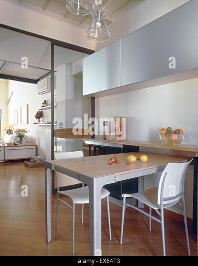 Interior View Of Modern Kitchen Overlooking On Living Room With Wood Floor In Foreground The