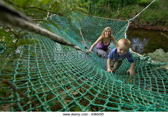 mother and child on hammock coromandel new zealand   stock image boy on hammock   stock photos  u0026 boy on hammock   stock images      rh   alamy