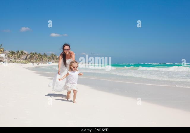 Little girl running along beach stock photos little girl for Mother daughter vacation destinations